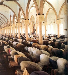 Muslims praying the Salat together, but it can be done alone, or even in the street.